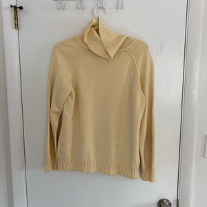 Light yellow colored turtleneck sweater